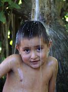 honduras boy taking bath agua caliente copan - stock photo