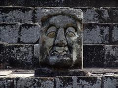 honduras stone head at copan mayan ruins latin - stock photo