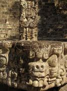 Honduras stelae and head carving in main plaza Stock Photos
