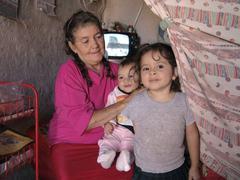honduras woman female with her in slum of - stock photo