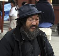 japan tramp at asakusa buddhist temple tokyo man - stock photo