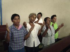 Nicaragua style praying during sunday mass in Stock Photos