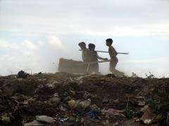 nicaragua boys scavenging on the managua garbage - stock photo