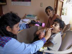 el salvador nurse examining child kid at health - stock photo