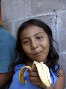 El salvador girl eating banana san francsico Stock Photos