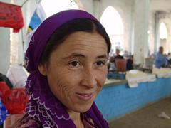 Uzbekistan woman female in the market at 2005 Stock Photos