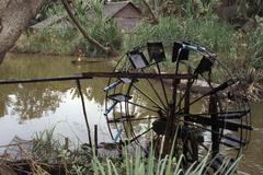 cambodia water wheel used for raising in order - stock photo
