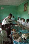 Ethiopia archbishop epiphanos talking to orphan Stock Photos
