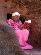 ethiopia monk in pink abba gebra kidan staying - stock photo
