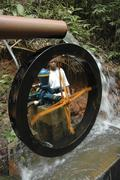 Brazil water wheel driven by stream operating to Stock Photos