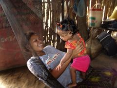 Colombia mother child kid in hammock photo 2005 Stock Photos