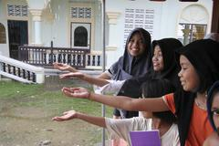 Thailand moslem girls catching raindrops pattani Stock Photos