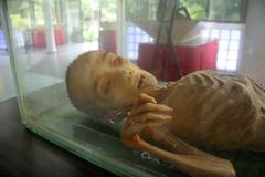 thailand life museum macabre exhibit of mumified - stock photo