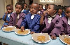 ethiopia children kids eating lunch shiro meda - stock photo