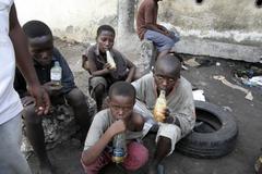 kenya street kids of mombasa sniffing glue drugs - stock photo