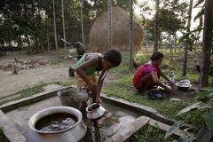 bangladesh early morning ablutions for garo of - stock photo