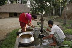 Bangladesh early morning ablutions for garo of Stock Photos