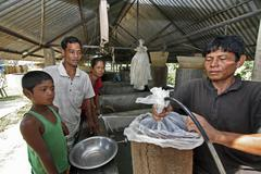 Bangladesh family buying fish for stocking the Stock Photos