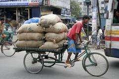 Bangladesh many carrying heavy load on bicycle Stock Photos