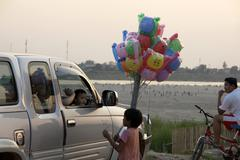 Stock Photo of laos child kid selling baloons vientiane asia