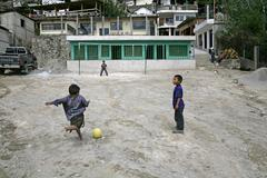 Guatemala boys playing football santa catarina Stock Photos