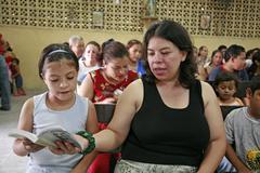 honduras the during catholic mass slum barrio of - stock photo
