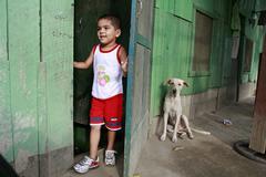honduras boy and dog the slum barrio of san - stock photo