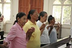 Stock Photo of honduras women females in church the slum barrio