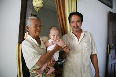 indonesia rustam with wife and child kid tsunami - stock photo