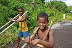 Fiji boys playing with thier cars taveuni south Stock Photos