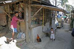 Small shop and street scene in slum quezon city Stock Photos