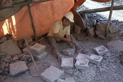Chile man male making stone artifacts in quarry Stock Photos