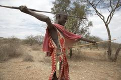 kenya young masai boy armed with spear and sord - stock photo