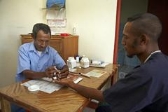 Timor leste taking drop of blood from man male Stock Photos
