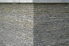 wall from a granite brick - stock photo