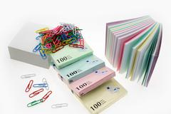 Many a new scratch paper and paper clips Stock Photos