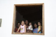 Brazil women females and children kids in window Stock Photos