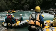 Raft filled with people, lots of people foreground Stock Footage