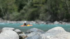 Blurred shot of a man in a canoe or kayak in a river Stock Footage