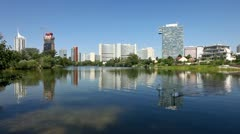 Skyline Uno City Vienna in summer at the Kaiserwasser - stock footage