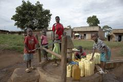 Uganda hand pumped bore hole in use village of Stock Photos