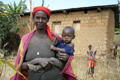 Burundi woman female and child kid gitera by Stock Photos