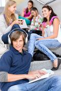 students sitting on high-school stairs in break - stock photo