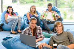 Students sitting on beanbags in study room in study room Stock Photos