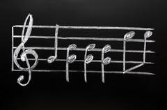 Clef on a blackboard Stock Photos