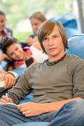 high-school students in study room reading writing - stock photo