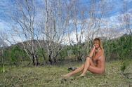 Beautiful nude blonde outdoors Stock Photos