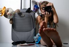 young photographer and traveler - stock photo
