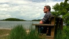 Man on beach bench; 2 Cape Cod Stock Footage