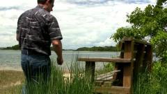 Man on beach bench Cape Cod Stock Footage